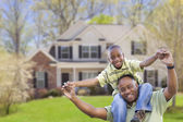 Playful African American Father and Son In Front of Home — Stock Photo