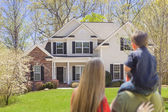 Mixed Race Young Family Looking At Beautiful Home — Stock Photo