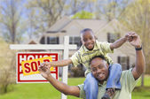 Father and Son In Front of Real Estate Sign and Home — Stock Photo