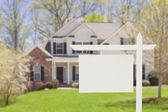 Blank Real Estate Sign in Front of New House — Stock Photo