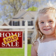 Cute Girl in Yard with Sold For Sale Real Estate Sign and House — Stock Photo #27795053