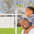 Father and Son In Front of Blank Real Estate Sign and House — Stock Photo