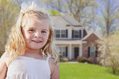 Cute Smiling Girl Playing in Front Yard — Stock Photo