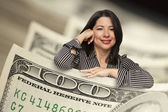 Hispanic Woman Leaning on a One Hundred Dollar Bill — Stock Photo