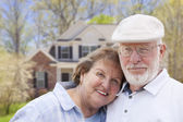 Happy Senior Couple in Front of House — Stock Photo