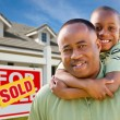 African American Man and Child with Home — Stock Photo #2797262