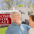 Happy Senior Couple Front of For Sale Sign and House — Stock Photo #28005055