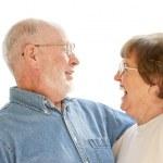 feliz pareja senior riendo en blanco — Foto de Stock