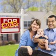 Stock Photo: Young Family in Front of Sold Real Estate Sign and House
