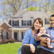 Happy Mixed Race Couple in Front of House — Stock Photo #28005715