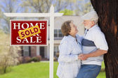 Sold Real Estate Sign with Senior Couple in Front of House — Stock Photo