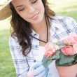 Young Adult Woman Wearing Hat Gardening Outdoors — Stock Photo #28179475