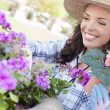 Young Adult Woman Wearing Hat Gardening Outdoors — Stock Photo