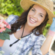 Young Adult Woman Wearing Hat Gardening Outdoors — Stockfoto