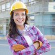 Young Attractive Female Construction Worker Wearing Hard Hat and — Stock fotografie #28368963