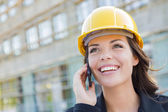 Young Female Contractor Wearing Hard Hat on Site Using Phone — Stock Photo