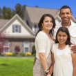 Small Hispanic Family in Front of Their Home — Stock fotografie