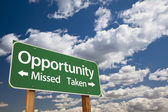 Opportunity Missed and Taken Green Road Sign and Clouds — Stock Photo