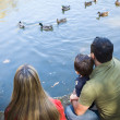 Mixed Race Mother and Father with Son at the Pond — Stock Photo #28598491