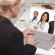 Woman In Kitchen Using Laptop, Online with Nurses or Doctors — Stock Photo
