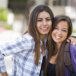 Mixed Race Female Students Carrying Backpacks on School Campus — Stock Photo #29323547