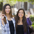 Mixed Race Female Students on School Campus With Okay Sign — Stock Photo #29323585
