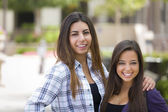 Mixed Race Female Students Carrying Backpacks on School Campus — Stockfoto