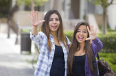 Mixed Race Female Students Waving Carrying Backpacks on School C — Stockfoto