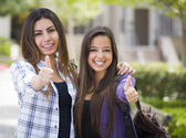 Mixed Race Female Students on School Campus With Thumbs Up — Stock Photo