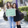 Mixed Race Female Students Holding Chalkboard With Back To Schoo — Stock Photo