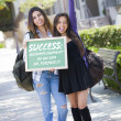 Mixed Race Female Students Holding Chalkboard With Success and D — Stock Photo #29622905