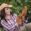 Young Adult Female Wearing Cowboy Hat and Gloves in Vineyard — Lizenzfreies Foto