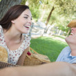 Mixed Race Couple with Guitar and Cowboy Hat in Park — Stock Photo #30634415
