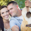 Mixed Race Couple Portrait with Guitar in Park — Foto Stock