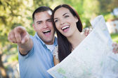 Mixed Race Couple Looking Over Map Outside Together — Stock Photo