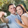 Happy Excited Couple with New House Keys — Stock Photo