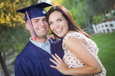 Male Graduate in Cap and Gown and Girl Celebrate — Stock Photo