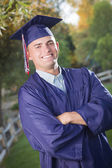 Handsome Male Graduate in Cap and Gown — Stock Photo