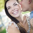 Stock Photo: Mixed Race Romantic Couple Whispering in Park