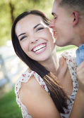 Mixed Race Romantic Couple Whispering in the Park — Stock Photo