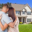Military Couple Looking at Nice New House — Stock Photo