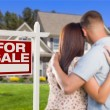 For Sale Real Estate Sign, Military Couple Looking at House — Stock Photo