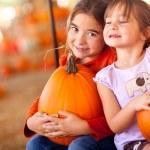 Cute Little Girls Holding Their Pumpkins At A Pumpkin Patch — Stock Photo #32684713