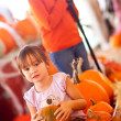 Stock Photo: Cute Girl Riding Wagon with Her Pumpkin and Sister