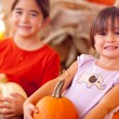 Stock Photo: Cute Little Girls Holding Their Pumpkins At Pumpkin Patch