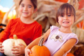Cute Little Girls Holding Their Pumpkins At A Pumpkin Patch — Stock Photo