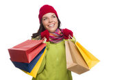 Mixed Race Woman Wearing Hat and Gloves Holding Shopping Bags — Stock Photo