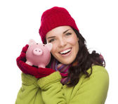 Happy Mixed Race Woman Wearing Winter Hat Holding Piggybank — Stock Photo