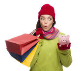 Concerned Mixed Race Woman Holding Shopping Bags and Piggybank — Stock Photo