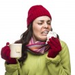 Sick Mixed Race Woman Drinks Hot Tea While Blowing Nose — Stock Photo